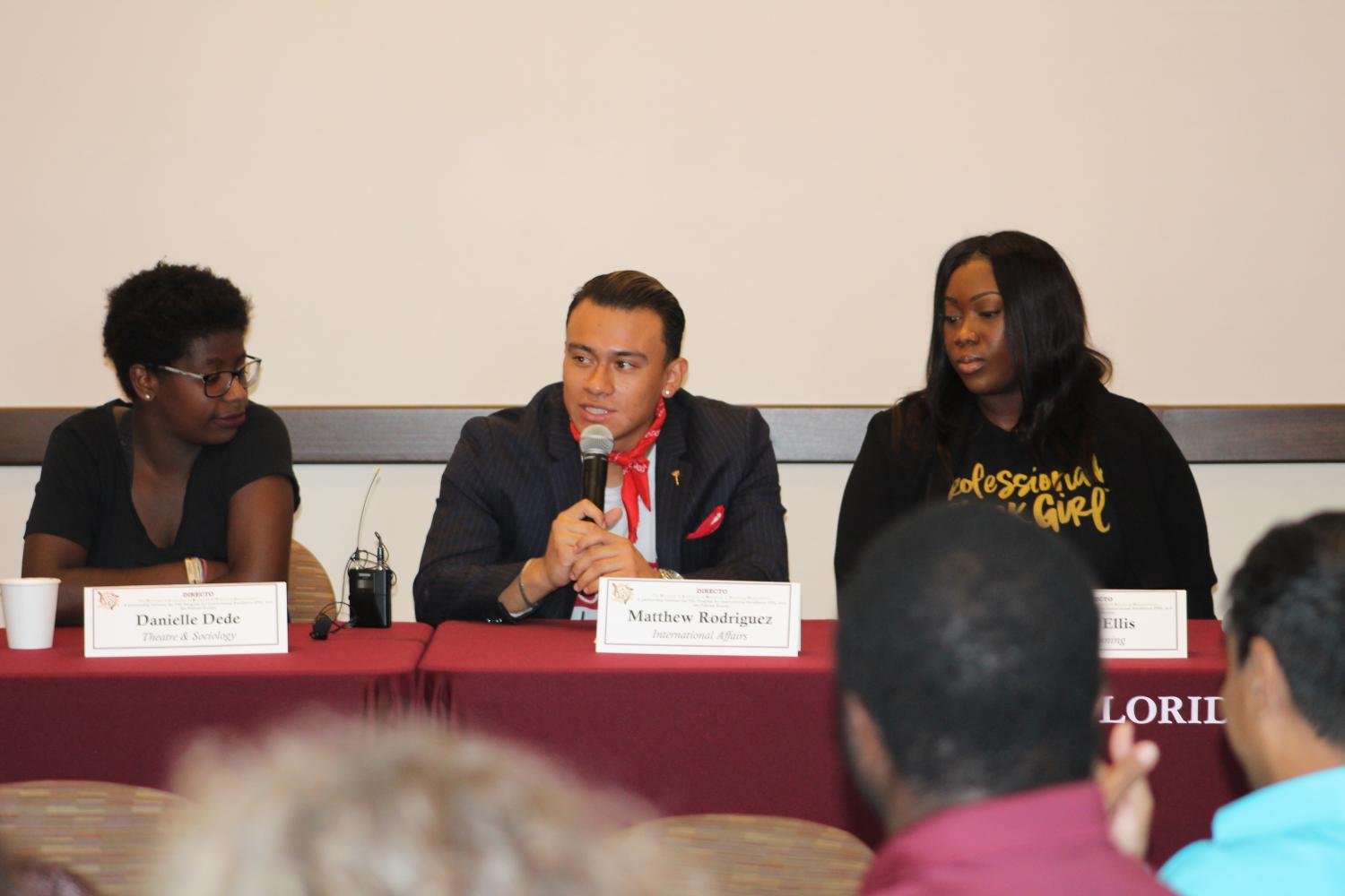 Matthew Rodriguez speaking in student panel at Inaugural Symposium