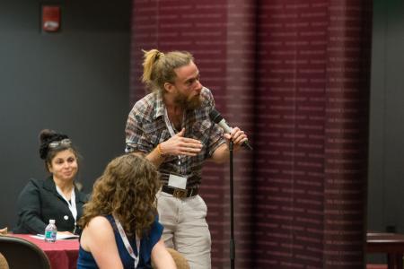Participant speaking at Fall Symposium